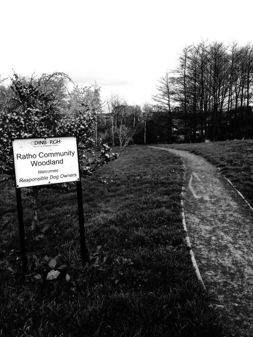 path through grass, sign saying 'ratho community woodland'
